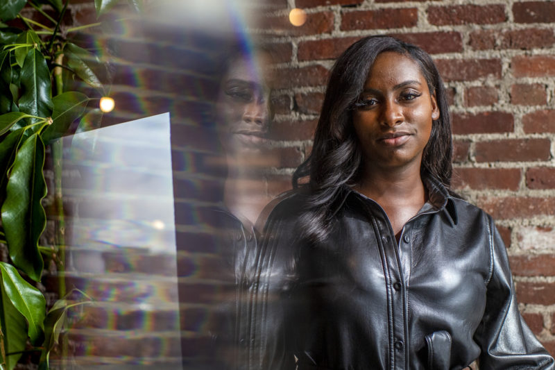 Northeastern graduate Camille Martin poses for a portrait at The Engine in Cambridge, Mass.